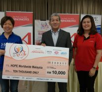 Mr Keiji Kaneko (middle)with the company of Ms. Lau Chin Mun (right) hand-over mock cheque to the Executive Director of HOPE Worldwide Malaysia, Ms. Katy Lee (left)